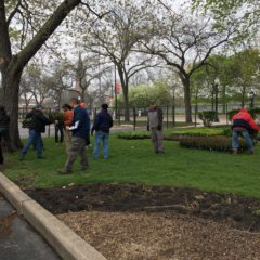 Grounds employees working a job